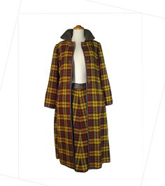 Early 1970s Vintage Bonnie Cashin plaid coat and skirt with leather trim.