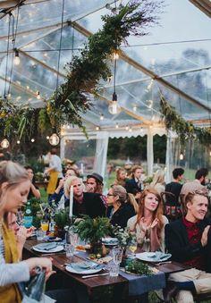 Marquee bWedding reception decorated garland and hanging light bulbs #weddingdecor #weddingreception #marqueewedding