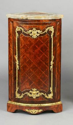 A Pair of German Régence ormolu-mounted tulip- and kingwood parquetry encoignures, Dresden, c. 1750
