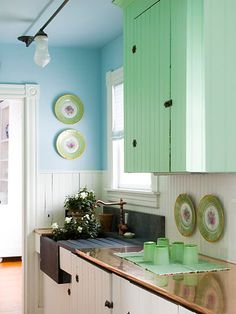 I like the color of the cabinets and how they have an old bead-board country kitchen look