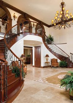 A double staircase cascased into the entrance foyer, inaugurating the guest to the regal surroundings. Rooms flow into rooms and the design elements are complementary.
