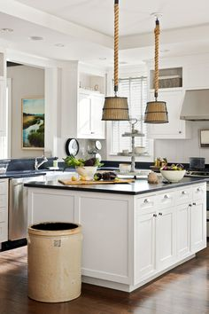 Designer Kevin Scanlon crafted the pendant lamps in this South Carolina kitchen out of crab baskets, rope, and burlap.When it comes to handsome trash cans, nothing tops an antique butter churn.
