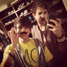 Austin and Alex with their mustaches they found in the garage!!!