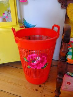 Love the idea of needlepointing on a plastic container! Not sure I like that particular design on that color, but its the concept that intrigues me!