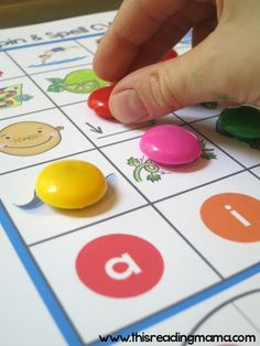 covering long vowel picture on game board with a Power Magnet