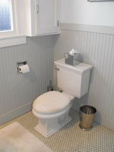 Reason not to do only hex tile...boring, shows grime too much. Good Home Construction's Renovation Blog: Vintage 1920's Bathroom with Hex Tile and Wood Wainscoting