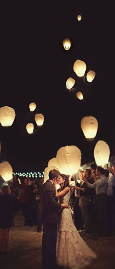 Release lanterns at end of beach wedding