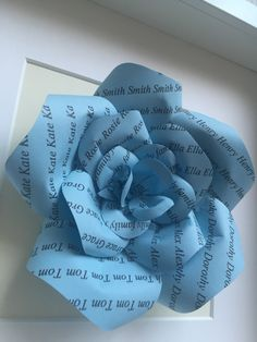 Brand new product from Karolina Rose! Personalised paper roses on coloured paper. Can feature family names or wedding dates. Great gifts for families and weddings too! See more colour choices on our Etsy shop... #WeddingFavours #GiftIdeas #PaperRoses #UniqueGift Framed or Unframed Blue Paper Rose