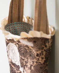 No, not wool. But cute tutorial for simple, rustic bags (burlap, even!) with great embellishments. Thanks to Cynthia Shaffer's blog for this one!