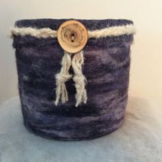 Violet Eminence is the name of this Eco friendly vessel.... Love the flameleaf sumac button.....  Lg wool vessel