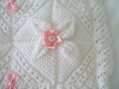 A lovely white DK pram cover with flowers and diamond shapes knitted in. It has peaks around the edging and has pink bows and pink flowers with pearl beads in the centre, sewed across the cover. It is padded and covered in satin material on the back. Baby Boy Knitting Patterns, Baby Patterns, Baby Knitting, Crochet Baby, Snowman Patterns, Knitted Afghans, Knitted Baby Blankets, Cot Blankets, Baby Shawl
