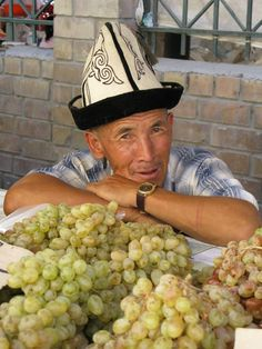 kyrgyzstan | farmer selling grapes in Kyrgyzstan. More photos are posted in a ...