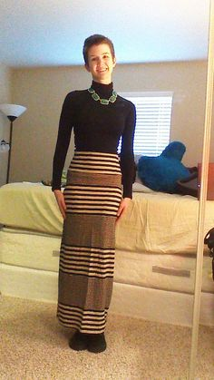 Daily Outfit!  Today I am wearing my new striped maxi skirt from Charlotte Russe. It is super comfortable and stretchy. To go with it I am wearing my new black turtle neck from H&M. To add color to the outfit, I am wearing my green and gold statement necklace from Charlotte Russe.