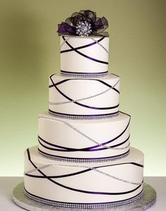 Wedding cake with criss cross ribbon detail.
