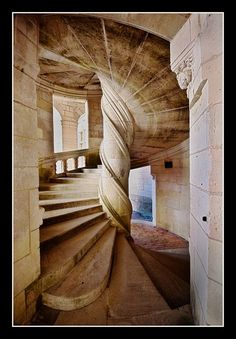 Chambord Castle, France. Stunning. I love spiral staircases anyway. This one, with the truly twisted central spindle is is almost esheresque. Plus Chambord=raspberries!
