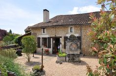 Renovated character stone village house near a river bank in the Poitou-Charentes