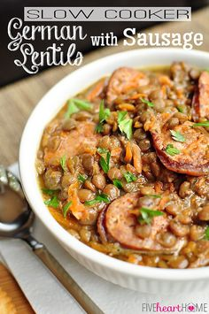 Slow Cooker German Lentil Soup is enhanced with sausage, carrots, and a flavorful broth that simmer the day away in a hearty, comforting, crockpot soup! Crock Pot Soup, Crock Pot Slow Cooker, Crock Pot Cooking, Slow Cooker Recipes, Crockpot Recipes, Sausage Crockpot, Kielbasa Sausage, Chicken Sausage, Lentil Recipes