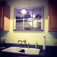 DIY kitchen window made w an old window and a 3.88 engineer print from staples. Photo by Adam Mullins Photography.
