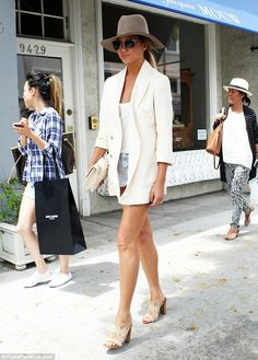 (via Chrissy Teigen steps out in jacket looking like she has gone without shorts | Daily Mail Online)