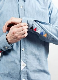 Simple coloured embroidery in an unusual place on a shirt create something a bit more interesting- subtle detail -