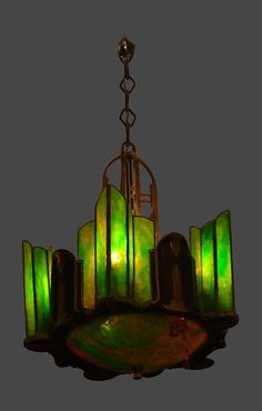 Art Deco Chandelier with Green & Caramel Stained Glass Slip Shades, ca Made me gasp, I Adore so many tings about this lamp! Lampe Art Deco, Art Deco Chandelier, Art Deco Lighting, Wall Sconce Lighting, Wall Sconces, Stained Glass Chandelier, Antique Chandelier, Antique Lamps, Art Nouveau