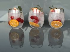 G&T garnished with orange, grapefruit, raspberries and thyme. Gin & Tonic Cocktails, Gin And Tonic, Craft Gin, Gin Lovers, Raspberries, Grapefruit, Wine Glass, Orange, Tableware