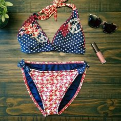 LUCKY BRAND   AMERICAN FLAG!  bikini set! PLEASE READ BELOW!!!  It's in great condition and is made of great quality!  Has minimum wear.  The top has little padding and ties in the back. This is perfect for 4th of July festivities!   UPDATE: I WAS ABLE TO FIND THE TAG (IT WAS ON OF THE BREAST POCKETS) SIZE SHOWS MEDIUM NOT SMALL LIKE PREVIOUSLY LISTED. Lucky Brand Swim Bikinis