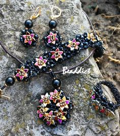 """""""Dragon Scale Flowers"""" set of earrings, ring, bracelet and pendant. Designed and beaded by Beaddict. Seed beads, fire polished beads, dragon scale beads."""
