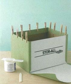 How to revamp a standard carboard storage box to look like one of those pricey ones in the Crate & Barrel catalog.