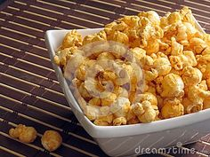 A late-night snack of cheese popcorn.