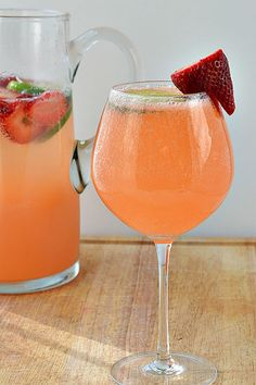 Strawberry & Lime Moscato Punch: Sweet Moscato is paired with strawberries, limeade, and a splash of 7-Up for a delicious drink that's easy to serve to groups. Click through to find more holiday drink recipes for your Easter party.