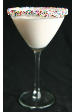 2 oz UV Cake Vodka 1 oz Disarrono Amaretto 1 oz Godiva White Chocolate Creme Liqueur 3 oz coconut cream Vanilla icing and sprinkles on the rim...sounds delicious!!