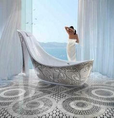 Shoe Bathtub-Designed by Massimiliano Della Monaca, a designer from Italy, the piece was adorned with beautiful mosaic tiles-this is a usable bathtub!