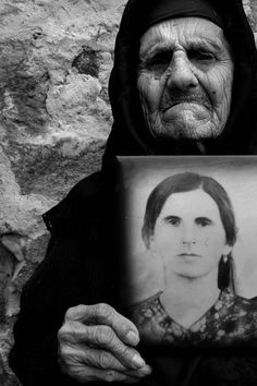 """Survivors"""" were eyewitnesses of the Armenian Genocide, the horrors that befell Armenians during the scourge by Ottoman Turkey in 1915-18. By Nazik Armenakyan -- I began this project in 2005. In the photographs of my project, survivors in black and white are holding a photograph of themselves when they were younger. For many of them, the photograph of their younger self is the only one they have and the photograph taken of me might be the last one."""