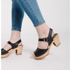 Step out in the trendy MIA Greta Heeled Peep-Toe Clog Sandal that features contrast topstitching, peep-toe front & a modern tractor sole set on a chunky, wooden heel. Available in 8 different color options. Clog Sandals, Tractor, Clogs, Peeps, Peep Toe, Contrast, Corner, Modern, Fashion