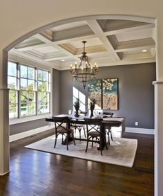 this is more of the grey I was thinking.  This is my favorite picture. I absolutely love this room and the openess and the color!!!  I also love the picture on the dinning wall