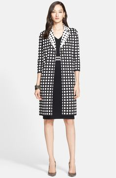 Free shipping and returns on St. John Collection Tubular Box Knit Topper at Nordstrom.com. A long, straight-cut topper makes a graphic statement in a chic black-and-white grid pattern. The reverse pattern styles the notch collar, offering bold contrast that draws the eye toward the face.