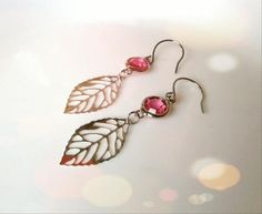 These+sparkly+earrings+are+made+of+little+silver+skeleton+leaves+that+hang+from+sparkling+hot+pink+Swarovski+crystal+glass+gems.+Silver+skeleton+leaf+pink+glass+gem+earrings+hang+on+silver+french+ear+wires.+Dont+miss+the+chance+to+pick+these+up+for+yourself+because+I+know+you+will+definitely+love...