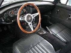 1969 MGC GT interior with classic sporty wood steering wheel.
