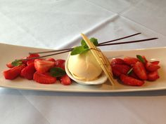Vanilla Ice Cream accompanied by lemon-glazed Strawberries and garnished with mint leaves  and Chocolate...refreshingly delightful!