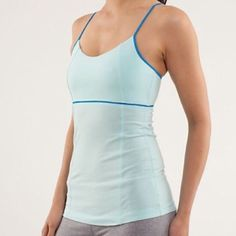 Lululemon Luminous tank top light blue Lululemon Athletica Luminous tank top in light blue, bright blue adjustable shoulder straps, built in shelf bra for optional paddings, light weight light support, tight fitted, preshrunk, made with Vitasea, size runs small, fits more like a Lululemon size 4-6, bust is too small for me, never worn, in brand new conditions. lululemon athletica Tops Tank Tops