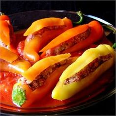 Bob's Stuffed Banana Peppers - Allrecipes.com  These are soooooo good! A perfect way to use up your gardens gifts!