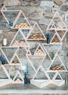 Use interesting shelving for a food or dessert display like this donut bar on a bookcase made of triangles Bridal Shower Desserts, Wedding Desserts, Wedding Decorations, Wedding Foods, Prom Decor, Wedding Things, Donut Bar, Doughnut, Dessert Table Decor
