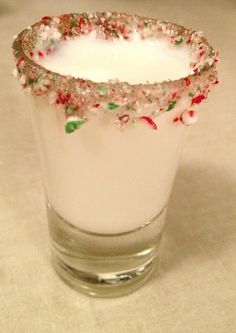 Wet the rim of a shot glass and dip into the crushed candy canes.    Mix equal parts Godiva white chocolate liqueur and Peppermint schnapps together, Shake and Pour into the rimmed shot glass and viola!