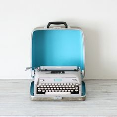 Typewriters-complete with carrying case.