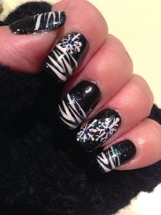 Black shellac with nails art and sparkle additive