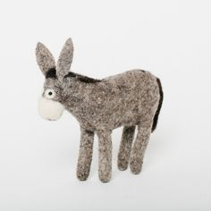 This Docile Donkey ornament is hand-felted from merino-blended wool in a magical studio run by an amazing woman artisan in Kyrgyzstan. All details and stitching are hand-embroidered. Fair Trade certified and made with love.  This Docile Donkey is a darling of our holiday markets. His bashful eyes and kindly gaze just melts our hearts! Craftspring partnered with JICA, the international development agency, to produce our Felted Fuzzies collection. All of these soft and fuzzy indigenous Kyrgyz…