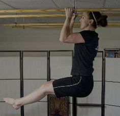 Stand on your massage table. Grip one hand on each bar and lift your legs up. Try to hold your legs up for at least 15 seconds.  Do this every day in between clients. It'll really help you in the long run.