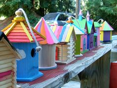 "Collection of colorful self painted bird houses. Birds are actually very smart, contrary to the term ""bird brain"" I love watching them and maybe with a bunch of these scattered all over my yard, i'll never have to watch tv again."