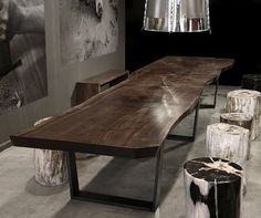 I hope I can afford one of these tables one day. Gorgeous, just gorgeous. (Hudson Furniture Inc. is New York's only repository for legally harvested petrified wood.)